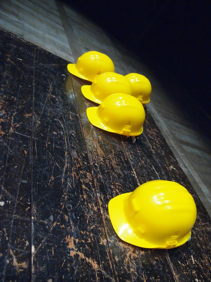 five yellow electrician caps